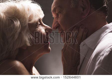 Senior Couple Looking At Eyes