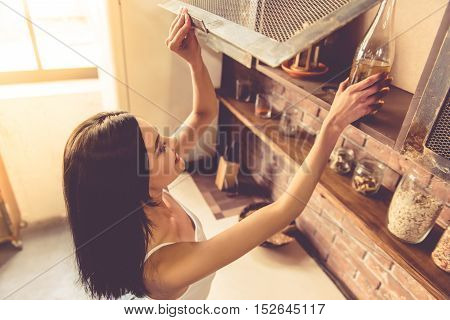 Beautiful Young Woman In Kitchen