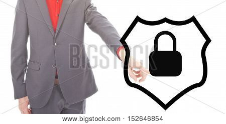 Young businessman with protection shield on white background