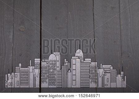 Office black skyline on dark wooden background