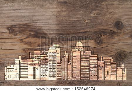White office skyline on brown wooden background