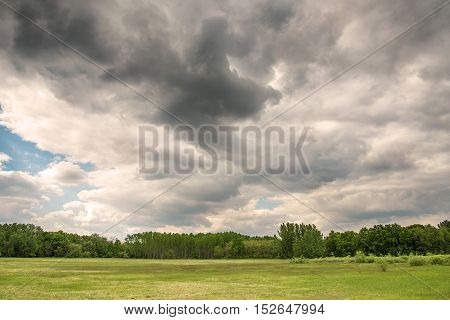 Beautiful landscape with dramatic sky detail .