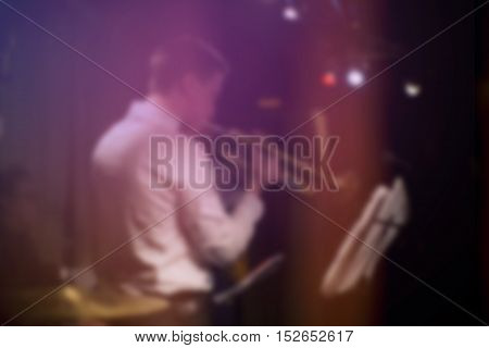 Blurred musician playing trumpet concert music, blurred background