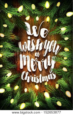 We Wish You A Merry Christmas. Christmas Card With Pine Wreath And Holiday Greetings On Wooden Backg