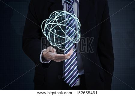 Entrepreneur standing and showing a global connection with digital planet in hands
