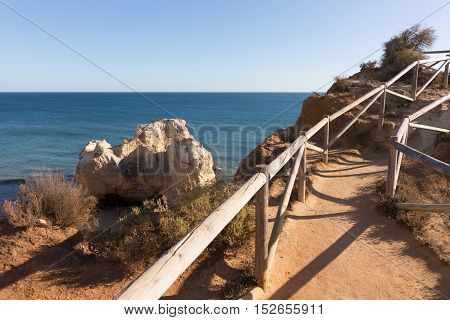 Wooden railings on the cliff at the coast in Portugal, Algarve
