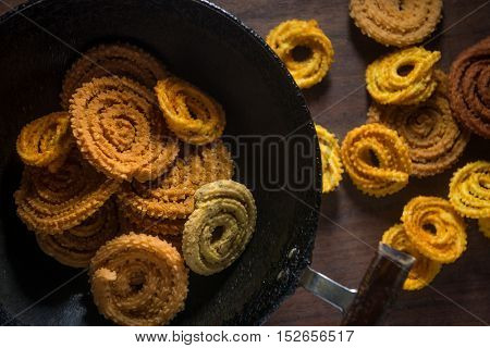 South indian homemade authentic snack - murukku, placed in a fry pan. Shot from above, An Indian homemade cuisine.