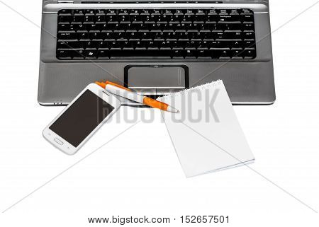 Laptop with a smartphone notebook and pen on a white background