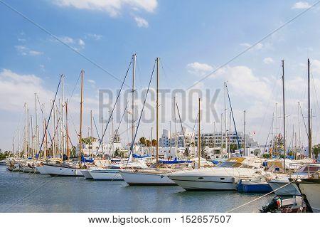 Sea port El Kantaoui Tunisia. Many yachts moored to the pier.
