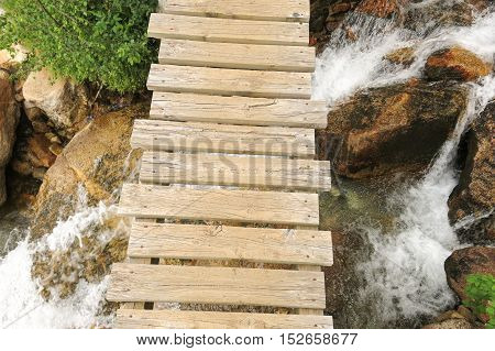 Small Bridge Over Creek Inside The Aigüestortes National Park