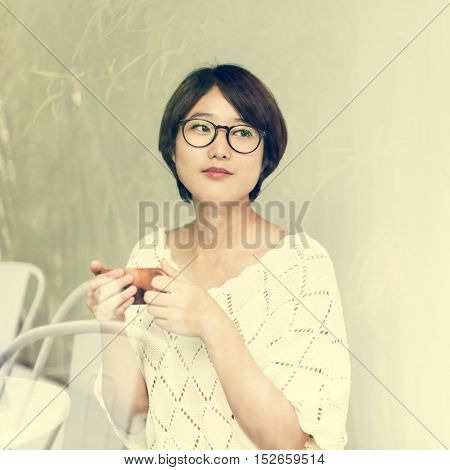 Asian Woman Drinking Tea Relax Concept