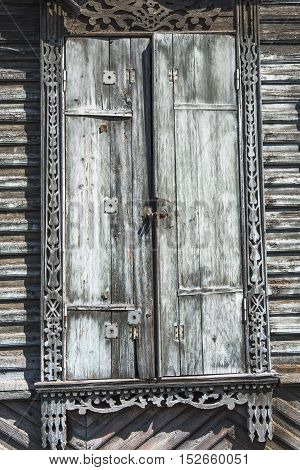 Authentic window of a wooden house, which can often be found on the streets of Irkutsk.