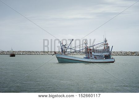 traditional fishing boat laying on the sea.cloudy sky.filtered image.selective focus