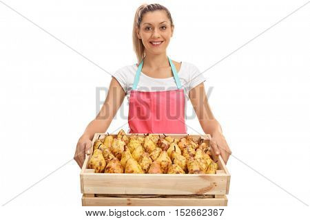 Happy female vendor holding a crate full of pears isolated on white background