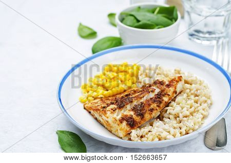 spices Cod with brown rice spinach and corn