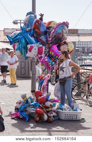 Street Vendor Sells Balloons On The Waterfront In Yafo, Israel