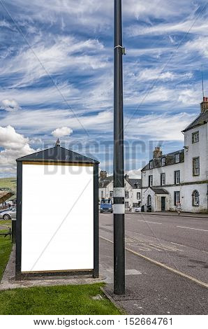 An image of a bus stop with a blank bilboard for your advertising situated in the Scottish town of Inverary.
