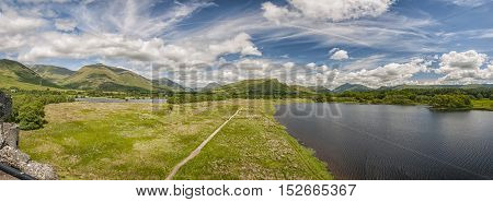 A panoramic image of Loch Awe in Argyll and Bute Scotland from the kilchurn castle ruins.