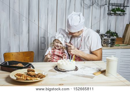 Family, Happy Daughter With My Dad At Home In The Kitchen Laughing And Baking A Birthday Cake Togeth