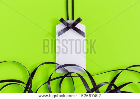 Gift Tag With Ribbon On Green
