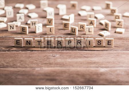 Business company conceptual word enterprise collected of elements of wooden elements with the letters
