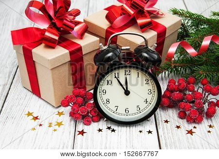 Christmas Clock On A  Wooden Background