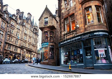 EDINBURGH SCOTLAND - SEPTEMBER 17 2014: Famous shops at Cockburn street in Old Town. It is a very historical and touristic street with many cafes and shops