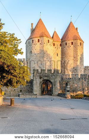 CARCASSONNE,FRANCE - AUGUST 30,2016 - Morning view at the Narbonnaise Gate in Carcassonne. Carcassonne is a fortified French town in the Aude department.
