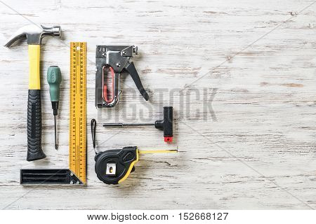 Variety of repair tools on wooden surface