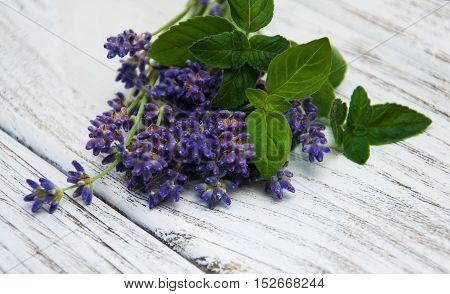 Lavender and mint on a old wooden table