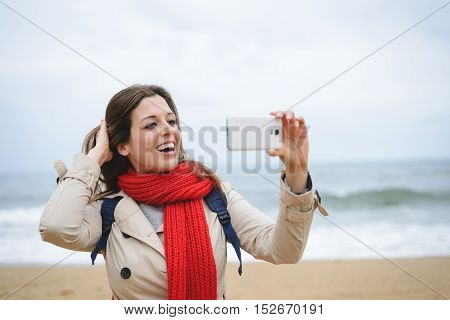 Woman Taking Selfie Photo With Smartphone On Autumn