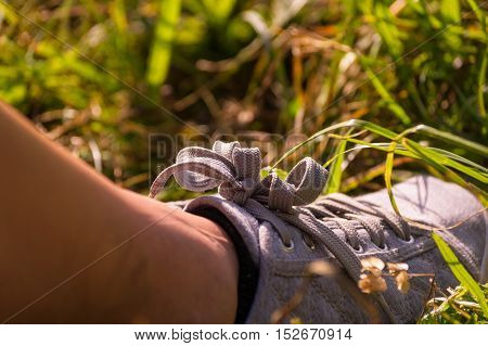 Close up of  feet in the grass on a sunny day
