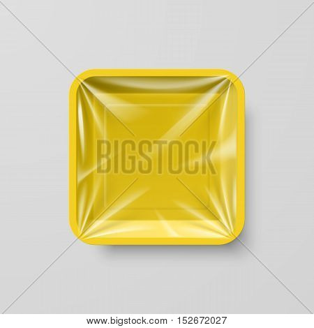 Empty Yellow Plastic Food Square Container on Gray