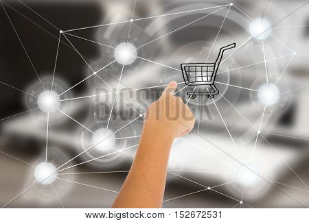 Mobile shopping concept - hand pointing on cart