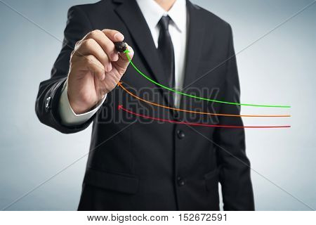 Benchmarking and market leader concept. Manager (businessman coach leadership) draw graph with three lines one of them represent the best company in competition.