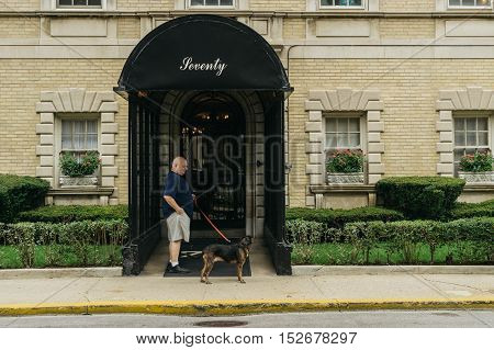 Chicago USA - September 25 2015: Man and a dog on a lane.