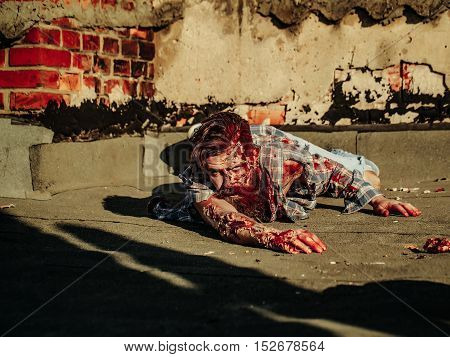 Zombie Man Crawls On Asphalt