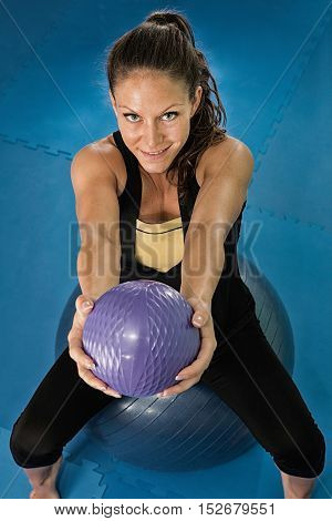 Young woman exercising at home gym, color image