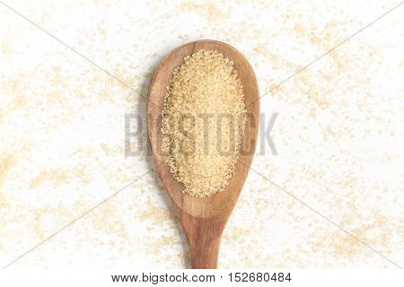 Demerara Sugar into a spoon isolated in white background