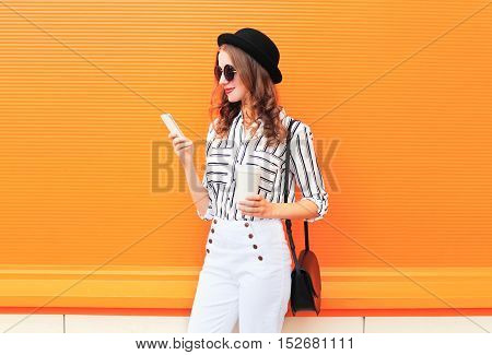 Fashion Pretty Young Woman Model Using Smartphone With Coffee Cup Wearing Black Hat White Pants Over