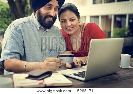 Indian Couple Using Device Concept