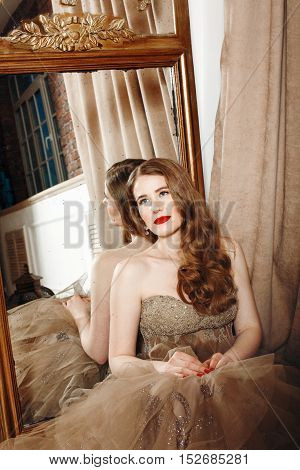 Beautiful Pensive Woman With Red Lips In Cocktail Evening Dress