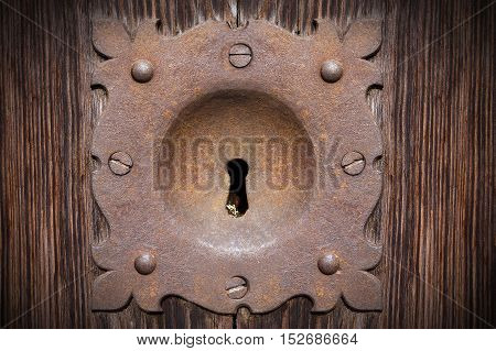Detail of an old and rusty keyhole of a wooden door in Verona Veneto Italy