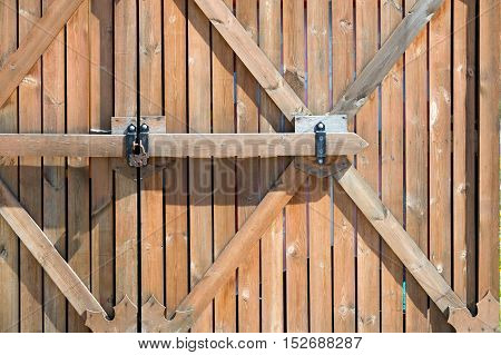 Wooden Fence. A Barrier, Railing, Or Other Upright Structure, Typically Of Wood Or Wire, Enclosing A
