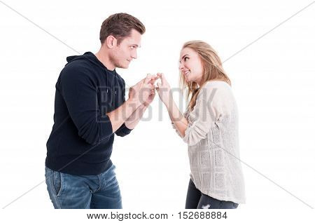 Attractive Couple Showing Fingers Crossed To Each Other