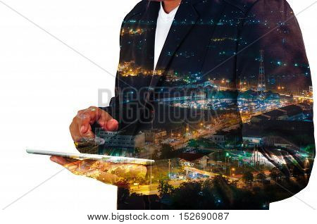 Businessman use Mobile phone with City and Communication Antenna Tower at Night Double Exposure as Wireless Telecommunication Technology concept.