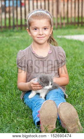 girl and cat on grass. A close up