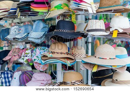 Hats on the shelfs in clothing store
