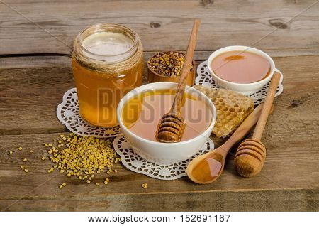 Bee Products (honey, Pollen,honeycombs) On Wooden Background
