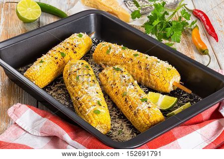 Grilled Corn Sprinkled With Parsley And Grated Parmesan